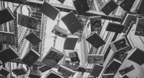 Black and white books suspended in the air